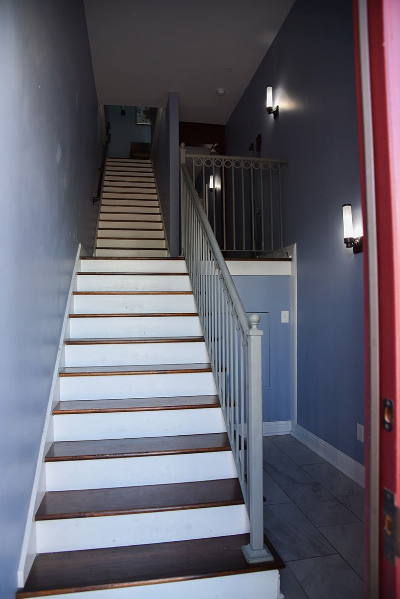 karam lofts galveston stairs in entryway