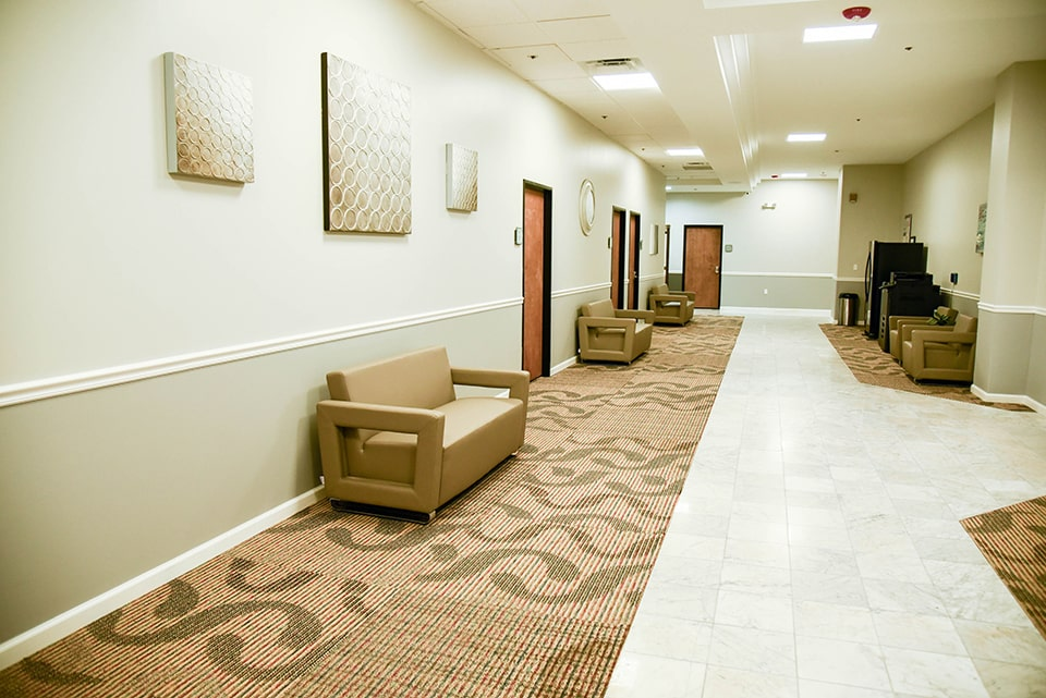 hallway with sitting area at mainland city suites